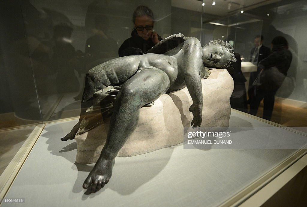 """To go with story by Sebastian Smith 'US-LIFESTYLE-ART-HOLIDAY-HISTORY-GREECE-VALENTINES' A statue of 'Sleeping Eros"""" is on display during a press preview of the Sleeping Eros exhibition at the Metropolitan Museum in New York, February 4, 2013. The statue of Eros, the god of love in Greek mythology, was acquired by the Metropolitan Museum in 1943. It was believed to be an original Hellenistic sculpture or a close replica created between 250 and 150 B.C. Subsequently, some scholars have suggested that it is a very fine Roman copy of one of the most popular sculptures ever made in Roman Imperial times. Recent research supports the former identification, but also makes apparent that it was restored in antiquity, most likely in the Early Imperial period. AFP PHOTO/Emmanuel Dunand"""