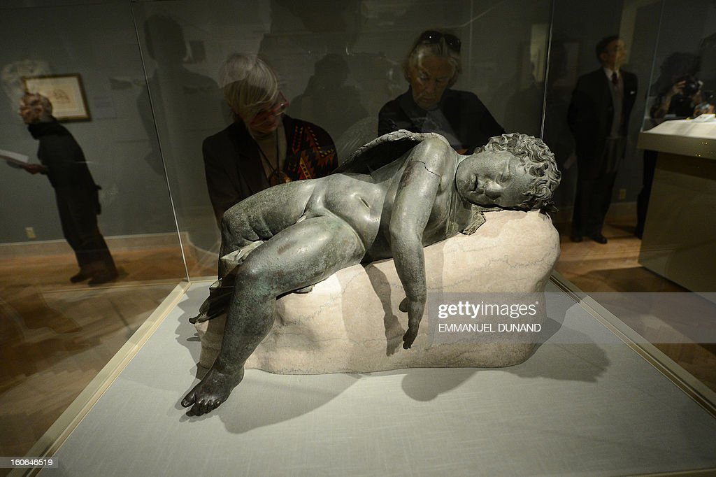 """To go with story by Sebastian Smith 'US-LIFESTYLE-ART-HOLIDAY-HISTORY-GREECE-VALENTINES' A statue of 'Sleeping Eros"""" is on display during a press preview of the Sleeping Eros exhibition at the Metropolitan Museum in New York, February 4, 2013. The statue of Eros, the god of love in Greek mythologie, was acquired by the Metropolitan Museum in 1943. It was believed to be an original Hellenistic sculpture or a close replica created between 250 and 150 B.C. Subsequently, some scholars have suggested that it is a very fine Roman copy of one of the most popular sculptures ever made in Roman Imperial times. Recent research supports the former identification, but also makes apparent that it was restored in antiquity, most likely in the Early Imperial period. AFP PHOTO/Emmanuel Dunand"""