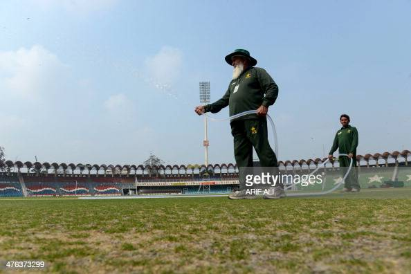 To go with story 'CricketPakistanunrestBasheer' by Shahid Hashmi In this photograph taken on March 1 Pakistani Haji Basheer prepares the pitch of the...