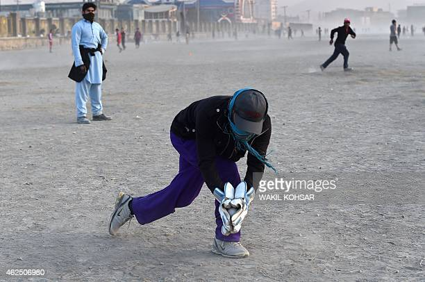 To go with story 'CricketWC2015AFG' by Mushtaq MOJADDIDI In this photograph taken on January 9 an Afghan cricket player fields the ball during a...