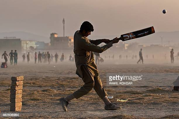 To go with story 'CricketWC2015AFG' by Mushtaq MOJADDIDI In this photograph taken on January 9 an Afghan cricket batsman hits the ball during a...