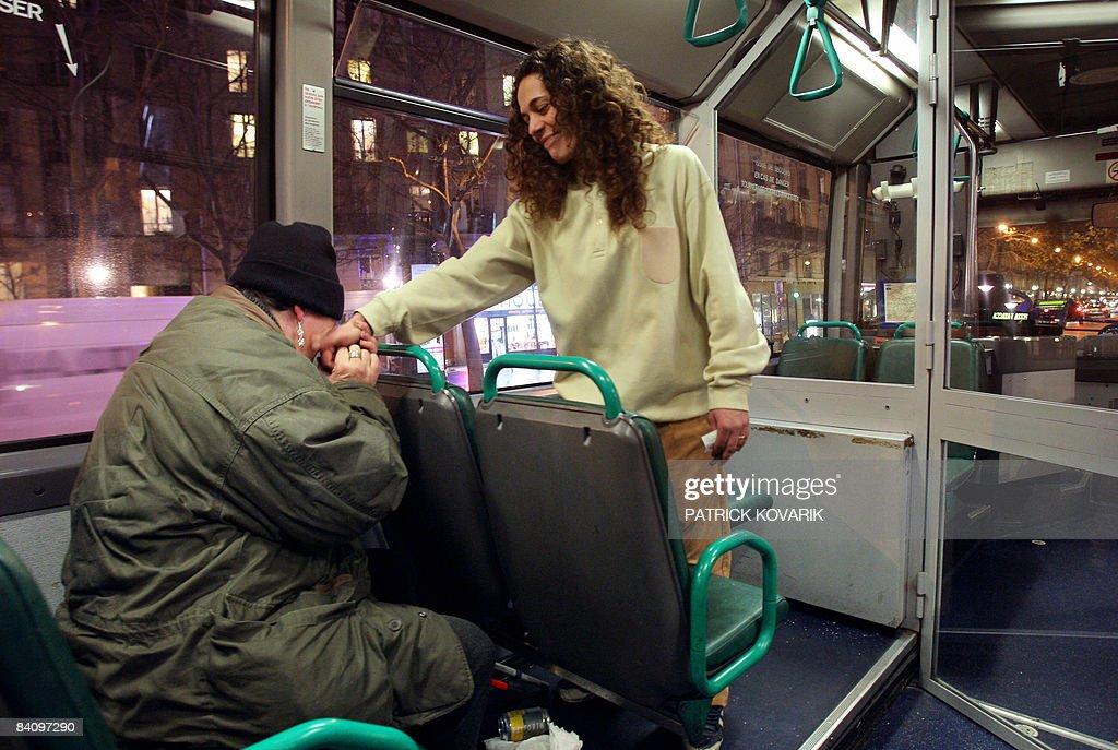 To go with story in French by Annick Benoist 'La souffrance insensée des naufragés de la rue' A homeless woman kisses the hand of Jocelyne a RATP...