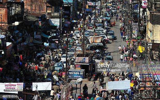 To go with story 'Indiaeconomyurbanisation' by Trudy HARRIS In this photograph taken on March 4 2015 Indian commuters travel along a busy road during...