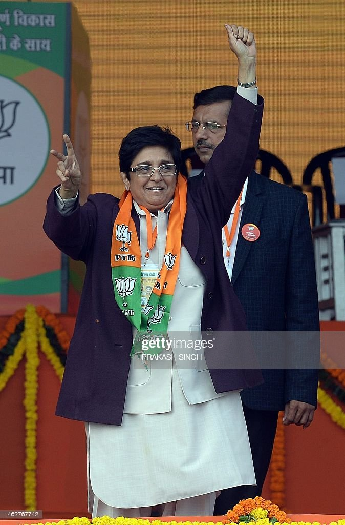 To go with story 'India-election-Delhi' by Bhuvan BAGGA In this photograph taken on February 3, 2015, the Bharatiya Janata Party (BJP) candidate for Delhi chief minister, <a gi-track='captionPersonalityLinkClicked' href=/galleries/search?phrase=Kiran+Bedi&family=editorial&specificpeople=2886102 ng-click='$event.stopPropagation()'>Kiran Bedi</a> waves during an election rally in New Delhi. Modi faces the first real test of his popularity on February 7 when voters in Delhi elect a new state government, with a self-styled anarchist bidding to stall the premier's bandwagon.