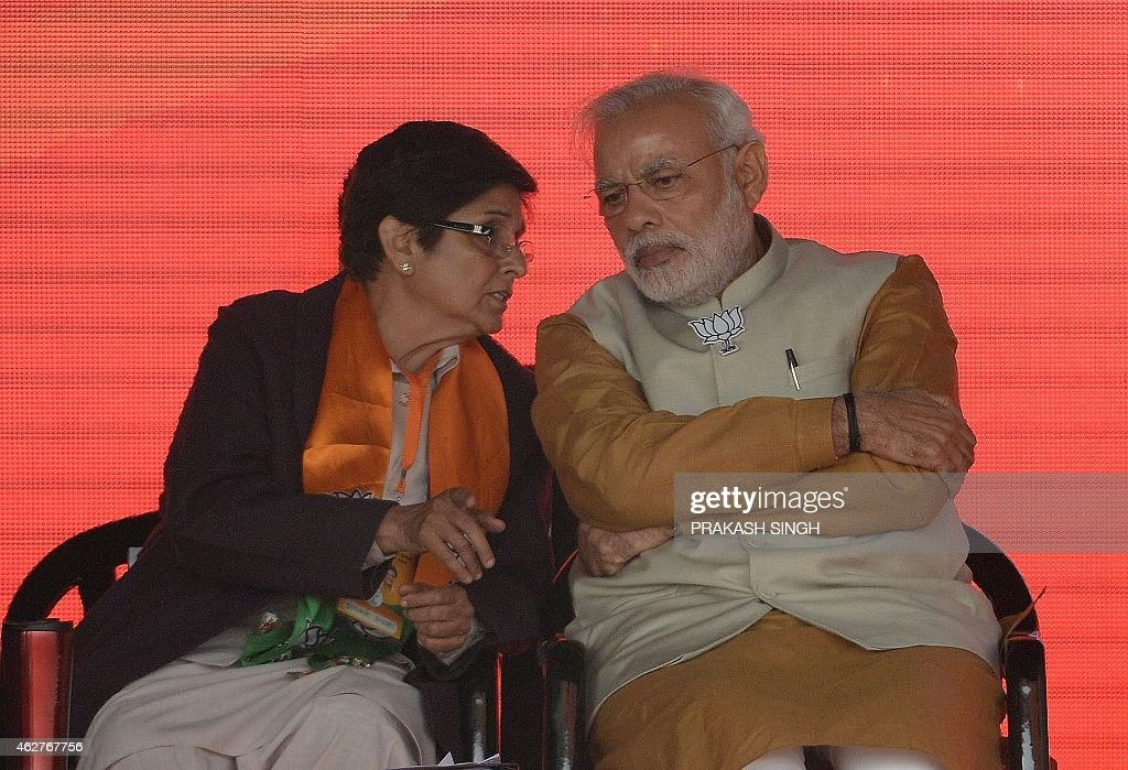 To go with story 'India-election-Delhi' by Bhuvan BAGGA In this photograph taken on February 3, 2015, Indian Prime Minister <a gi-track='captionPersonalityLinkClicked' href=/galleries/search?phrase=Narendra+Modi&family=editorial&specificpeople=822611 ng-click='$event.stopPropagation()'>Narendra Modi</a> (R) talks with the Bharatiya Janata Party (BJP) candidate for Delhi chief minister, <a gi-track='captionPersonalityLinkClicked' href=/galleries/search?phrase=Kiran+Bedi&family=editorial&specificpeople=2886102 ng-click='$event.stopPropagation()'>Kiran Bedi</a> during an election rally in New Delhi. Modi faces the first real test of his popularity on February 7 when voters in Delhi elect a new state government, with a self-styled anarchist bidding to stall the premier's bandwagon.