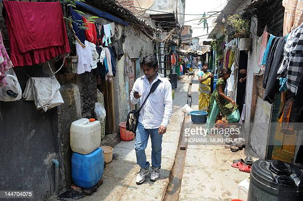 To go with story 'IndiamediasocialpovertytechnologyFEATURE' by Rachel O'Brien Video journalist and slum dweller Amol Lalzare checks his phone as he...