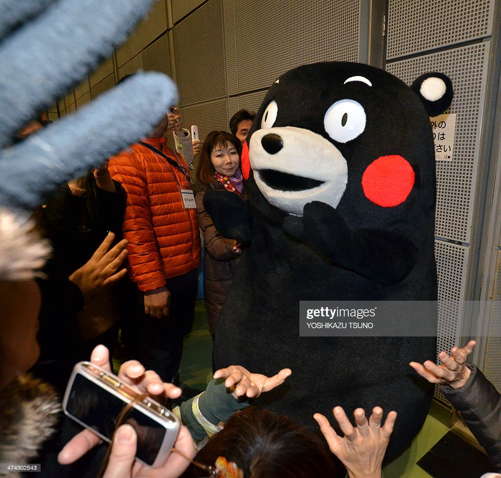 Japan-mascot-Kumamon-lifestyle-marketing-society by Hiroshi HIYAMA 'Kumamon,' a clumsy bear mascot of Kumamoto prefecture attends a food products event to promote products from Kumamoto prefecture in Tokyo on February 23, 2014. Most local mascots linger in relative obscurity but Kumamon draws hundreds of camera-toting fans at public events. He makes national television appearances and his wobbly signature dance -- once performed for the emperor and empress -- has notched up more than two million views on YouTube.AFP PHOTO / Yoshikazu TSUNO