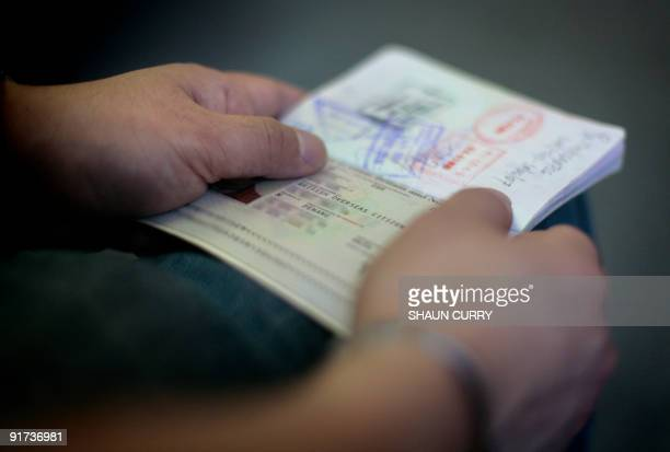 To go with story MalaysiaBritainimmigration by Romen Bose In a picture taken on August 6 a former Malaysian citizen known only as 'Dee' holds a...