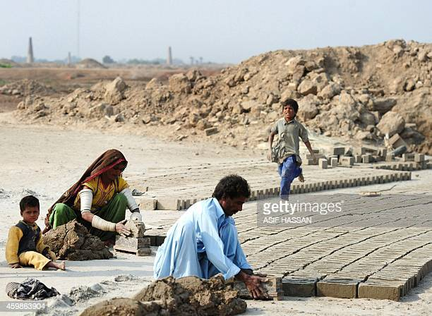 To go with story 'PakistanLabourRightsSlavery' by Guillaume Lavallee In this photograph taken on November 10 2014 a family of labourers make bricks...