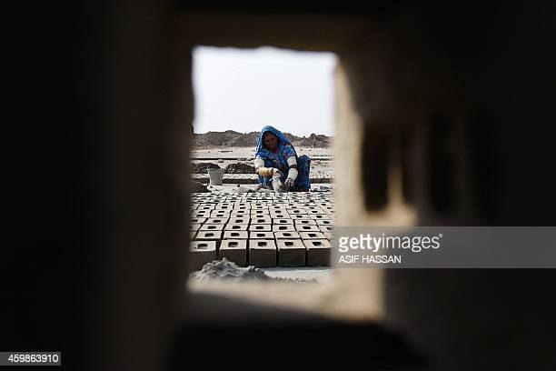 To go with story 'PakistanLabourRightsSlavery' by Guillaume Lavallee In this photograph taken on November 10 2014 a Pakistani labourer makes bricks...