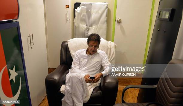 To go with story 'PakistanpoliticsunrestKhan' by Issam AHMED This photograph taken on September 8 2014 shows Pakistani cricketerturned politician...