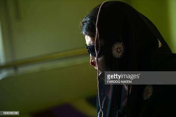 To go with story 'PakistansocialwomancrimeacidFEATURE' by Jennie Matthew In this photo taken on February 12 Naziran Bibi an acid attack victim waits...