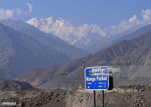 To go with story 'Pakistantourismnorth' by Gohar ABBAS In this photograph taken on August 7 2014 a sign points towards a view of Nanga Parbat the...