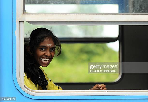 To go with story 'Sri Lankaunresttransporteconomy' by Amal JAYASINGHE In this photograph taken on October 1 2014 a Sri Lankan Tamil woman travels on...