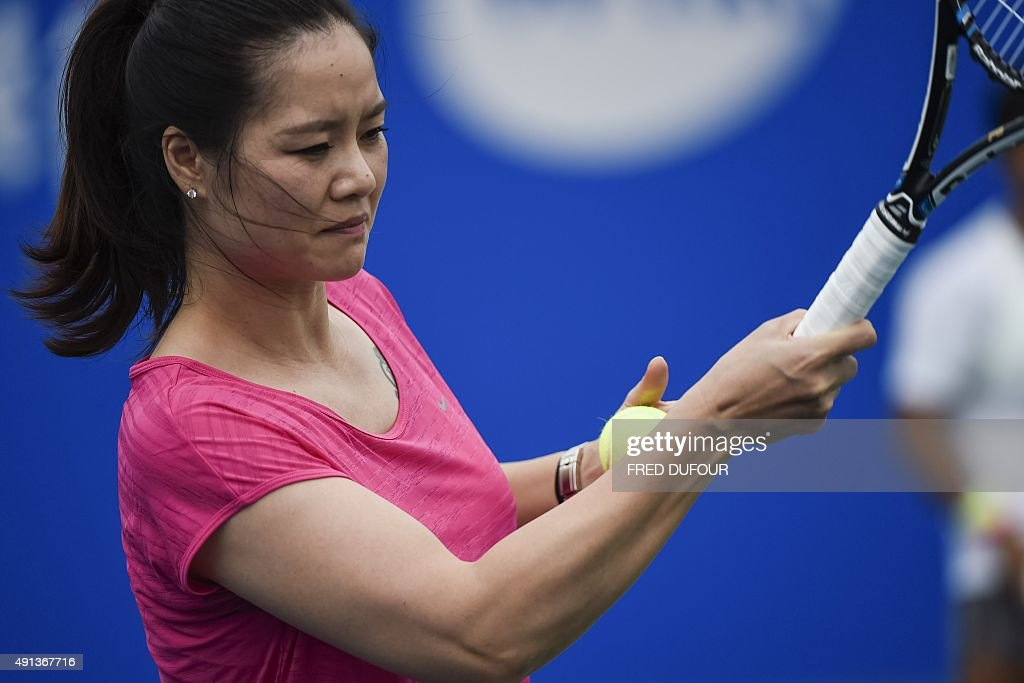 To go with Tennis-CHN-China-Li,FOCUS by Annanel Symington In this photo taken on September 29, 2015, former tennis player Li Na of China gives a tennis master class at the Wuhan Open tennis tournament in Wuhan, central China's Hubei province. Li Na's Grand Slam wins did miraculous things for tennis in China but a cultural shift away from central planning towards individual development is needed if the country is to emerge as a powerhouse, experts say. AFP PHOTO / FRED DUFOUR