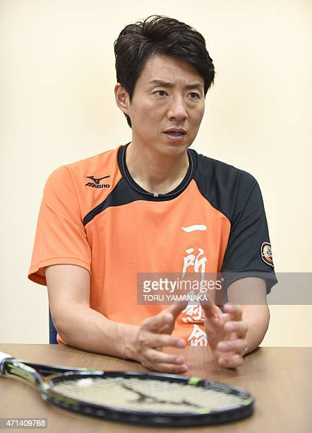 To go with TennisNishikoriJPNINTERVIEW by Alastair Himmer Former Japanese tennis star Shuzo Matsuoka gestures as he answers questions during an...