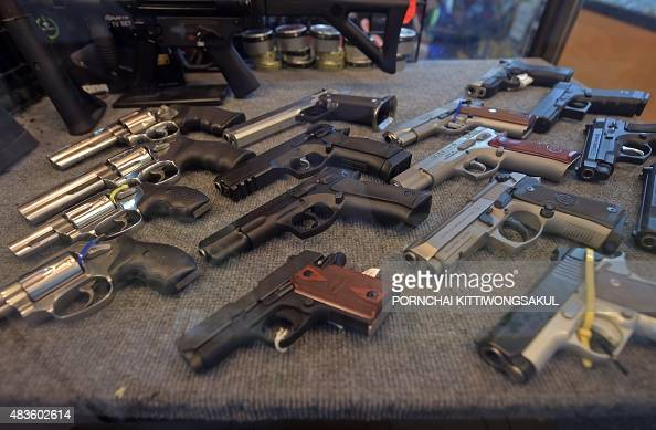 To go with ThailandlifestylecrimeFEATURE by Jerome Taylor This photo taken on July 22 2015 shows handguns displayed at a gun shop in Bangkok Some 61...