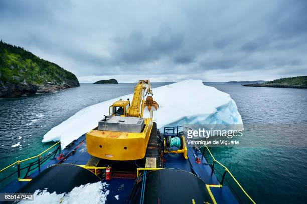 To harvest the iceberg Ed Kean uses a grabber who can take off a 500 kg of ice from the iceberg with each swipe As more icebergs drift south due to...