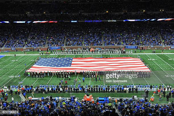 To honor the military this large flag is held by service members prior to the NFL football game between the Jacksonville Jaguars and Detroit Lions on...