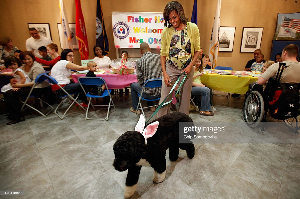 To kick off the Month of the Military Child, first lady <a gi-track='captionPersonalityLinkClicked' href=/galleries/search?phrase=Michelle+Obama&family=editorial&specificpeople=2528864 ng-click='$event.stopPropagation()'>Michelle Obama</a> and her dog Bo participate in a pre-Easter celebration with military families and children at the Fisher House on Walter Reed National Military Medical Center April 4, 2012 in Bethesda, Maryland. The Fisher Houses are 'comfort homes' that enable family members to be close to their military loved one during hospitalization for an unexpected illness, disease, or injury. Obama delivered Easter candies, visited with military children and gave away tickets to the White House Easter Egg Roll during the visit.