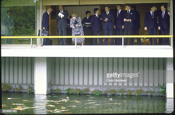 Francois Mitterrand Jacques Delors Ronald W Reagan Brian Mulroney Yasuhiro Nakasone Margaret H Thatcher and Bettino Craxi at fish pond outside...