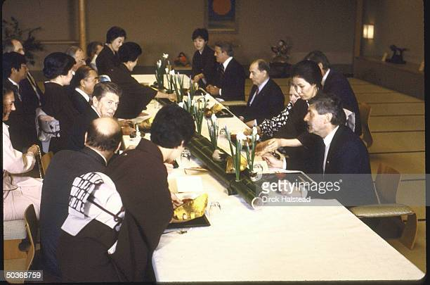 Unidentified man Margaret H Thatcher Francois Mitterrand Brian Mulroney Bettino Craxi Ronald W Reagan Yasuhiro Nakasone and others at lunch during...