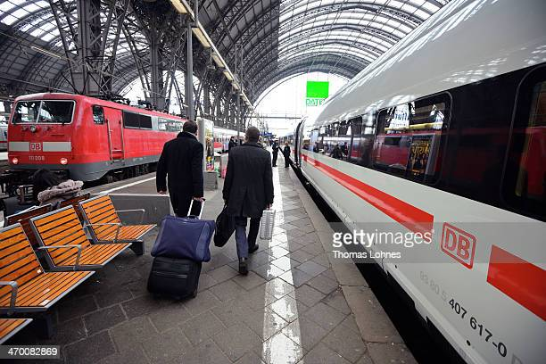 To passengers walk along the platform next to the latest generation of the ICE 3 Deutsche Bahn highspeed train version 407 during a media day from...
