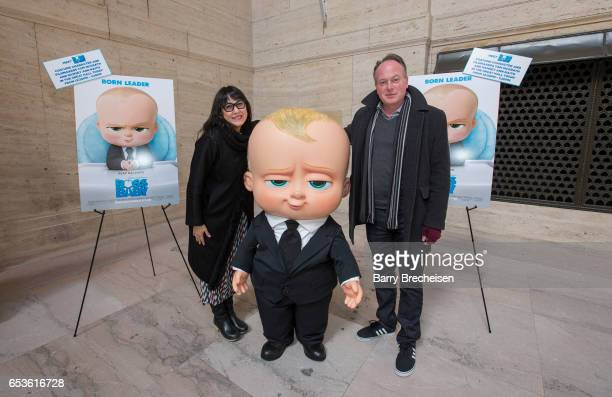 To promote the new DreamWorks movie 'The Boss Baby' director Tom McGrath and producer Ramsey Ann Naito posed with the costume character of The Baby...