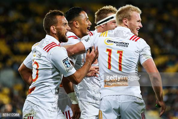 L to R Aaron Cruden Toni Pulu Sam Cane and Sam McNichol of the Chiefs celebrate a try during the round nine Super Rugby match between the Hurricanes...