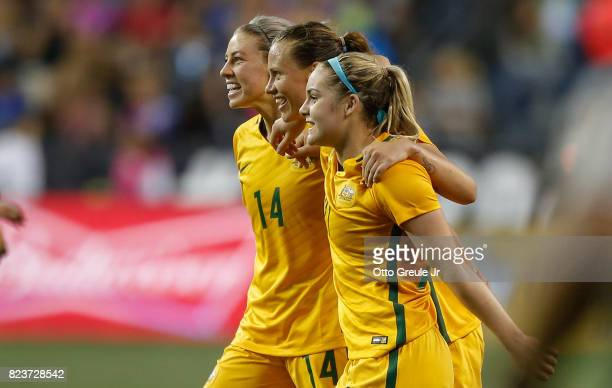 L to R Alanna Kennedy Emily Van Egmond and Ellie Carpenter of Australia celebrate after defeating the United States 10 during the 2017 Tournament of...