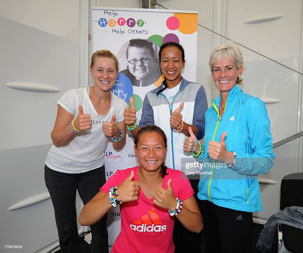 L to R, Alison Riske of USA , Anne Keothoavong of Great Britain, Judy Murray and Tara Moore of Great Britain (front) with their bracelets supporting the Help Harry Help Others Charity during the AEGON Classic Tennis Tournament at Edgbaston Priory Club on June 12, 2013 in Birmingham, England.