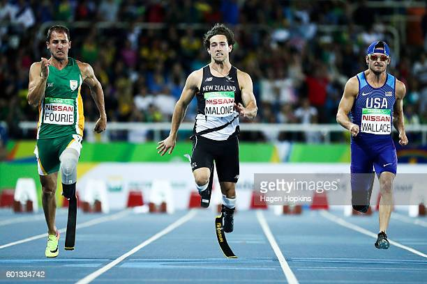 L to R Amu Fourie of South Africa Liam Malone of New Zealand and Jarryd Wallace of USA compete in the Men's 100m T44 on day 2 of the Rio 2016...