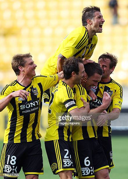 L to R Ben Sigmund Andrew Durante Vince Lia Tim Brown and Nick Ward of the Phoenix celebrate a goal during the round eight ALeague match between the...