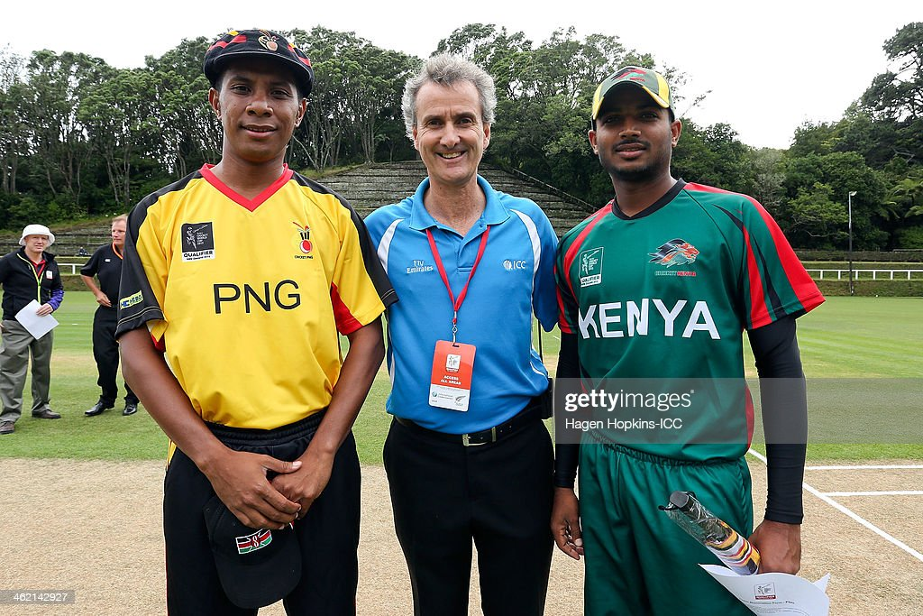 L to R, captain Chris Amini of Papua New Guinea, reserve umpire <a gi-track='captionPersonalityLinkClicked' href=/galleries/search?phrase=Billy+Bowden&family=editorial&specificpeople=228578 ng-click='$event.stopPropagation()'>Billy Bowden</a> and captain Rakep Patel of Kenya pose after the coin toss during the ICC Cricket World Cup Qualifier match between Kenya and Papua New Guinea at Pukekura Park on January 13, 2014 in New Plymouth, New Zealand.