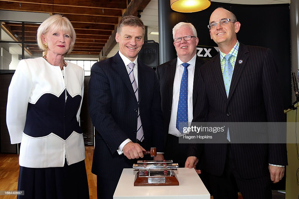 L to R, Chair of Mighty River Power Joan Withers, Minister of Finance <a gi-track='captionPersonalityLinkClicked' href=/galleries/search?phrase=Bill+English&family=editorial&specificpeople=772458 ng-click='$event.stopPropagation()'>Bill English</a>, NZX CEO Tim Bennett and Minister for State Owned Enterprises Tony Ryall pose during the listing of Mighty River Power at NZX on May 10, 2013 in Wellington, New Zealand. Mighty River Power is one of several state owned enterprises being partially sold by the Government to raise capital.