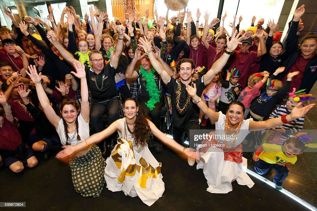 L to R, Chef de Mission Ben Lucas along with Paralympians Kate Horan, Chris Sharp and Liam Malone pose with school children and members of Brazilian percussion and dance group Batucada during Paralympics New Zealand's '100 Days To Go' event at Te Papa Museum on May 30, 2016 in Wellington, New Zealand.