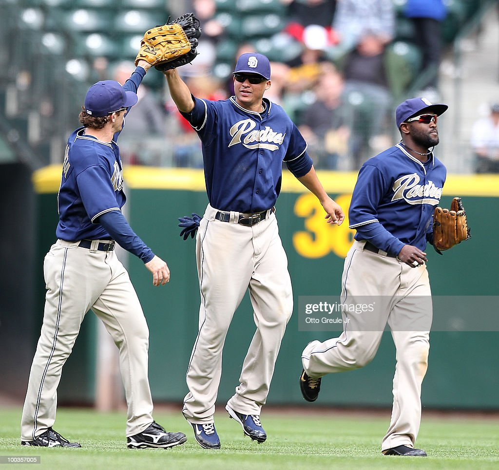L to R Chris Denorfia Will Venable and Tony Gwynn Jr #18 of the San Diego Padres celebrate after defeating the Seattle Mariners 81 at Safeco Field on...