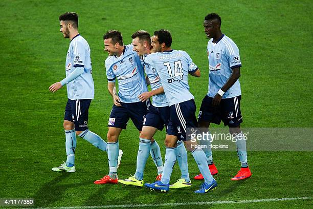 L to R Chris Naumoff Milos Dimitrijevic Shane Smeltz Alex Brosque and Bernie IbiniIsei of Sydney FC celebrate Smeltz's goal during the round 26...