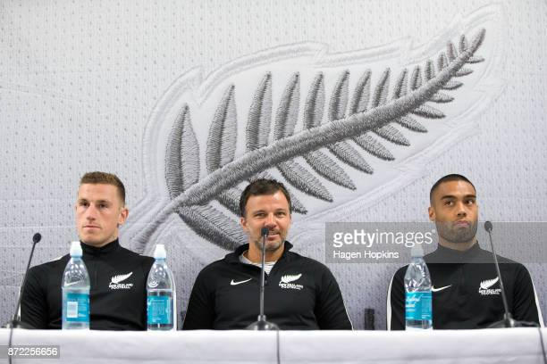 L to R Chris Wood coach Anthony Hudson and Winston Reid speak to media prior to a New Zealand All Whites training session at Westpac Stadium on...