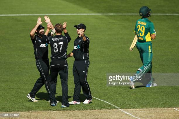 L to R Dean Brownlie Lockie Ferguson and Neil Broom of New Zealand celebrate the wicket of Dwaine Pretorius of South Africa during game three of the...