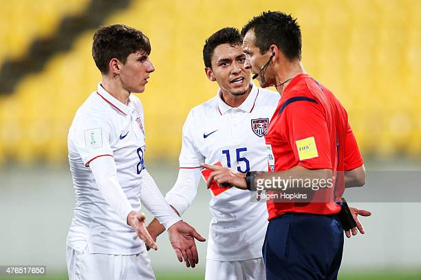 L to R Emerson Hyndman and Marco Delgado of USA appeal to referee Ivan Bebek of Croatia after showing a red card to teammate Kellyn Perry during the...