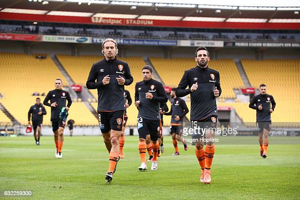 L to R Jacob Pepper Dimitri Petratos and Manuel Arana of the Roar leave the field after warming up during the round 16 ALeague match between the...