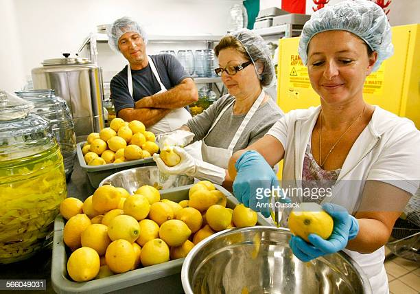 L to R James Carling watches as his mother in law Rossana Zaretti and wife Manuela Zaretti–Carling peel about 3000 lemons to make limoncello...