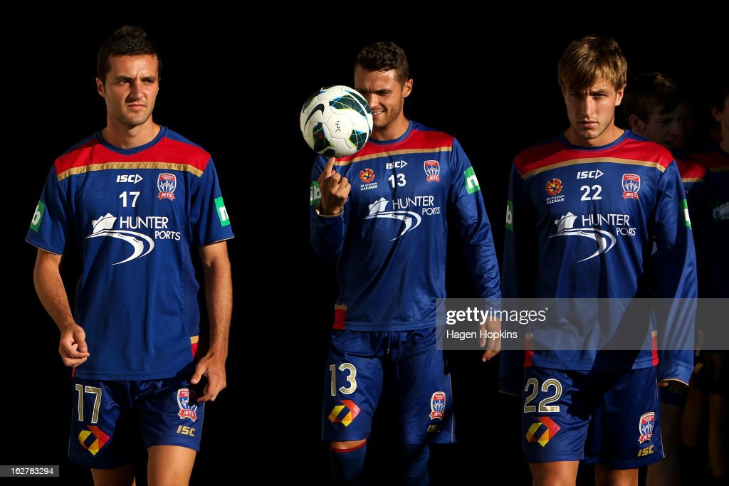 L to R, James Virgili, Sam Gallaway and Adam Taggart of the Jets exit the players tunnel during the round 26 A-League match between the Wellington Phoenix and the Newcastle Jets at Westpac Stadium on February 27, 2013 in Wellington, New Zealand.