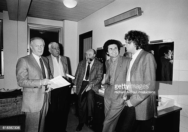 Le Grand Echiquier TV host Jacques Chancel with actors Charles Gerard Bernard Blier director Claude Lelouch and singer Michel Sardou