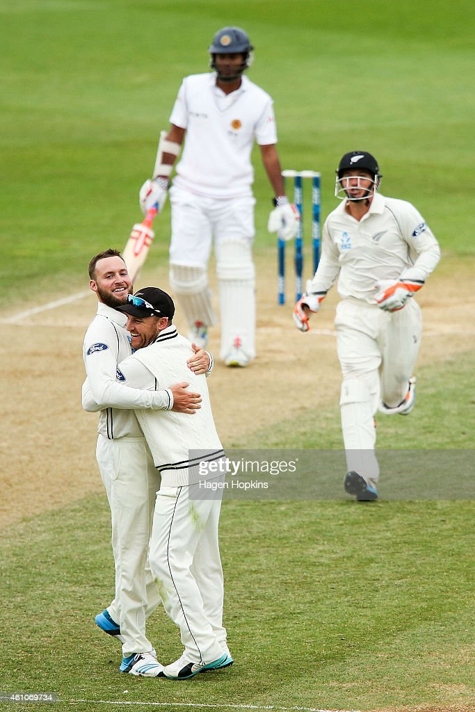 L to R Mark Craig Brendon McCullum and BJ Watling of New Zealand celebrate the wicket of Dimuth Karunaratne of Sri Lanka during day four of the...