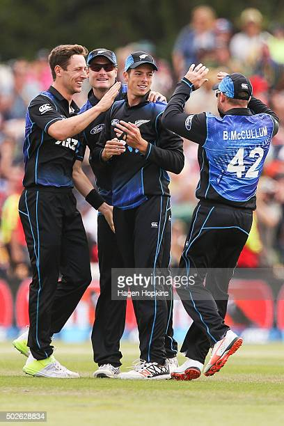 L to R Matt Henry Martin Guptill Mitchell Santner and Brendon McCullum of New Zealand celebrate the wicket of Danushka Gunathilaka of Sri Lanka...