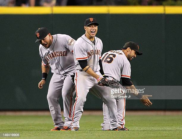 L to R Melky Cabrera Gregor Blanco and Angel Pagan of the San Francisco Giants celebrate after defeating the Seattle Mariners 42 at Safeco Field on...