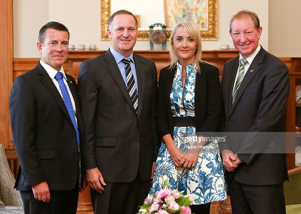L to R, Michael Woodhouse, Prime Minister <a gi-track='captionPersonalityLinkClicked' href=/galleries/search?phrase=John+Key&family=editorial&specificpeople=2246670 ng-click='$event.stopPropagation()'>John Key</a>, Nikki Kaye and Nick Smith pose after a swearing-in ceremony at Government House on January 31, 2013 in Wellington, New Zealand. After a recent Cabinet reshuffle by Prime Minister <a gi-track='captionPersonalityLinkClicked' href=/galleries/search?phrase=John+Key&family=editorial&specificpeople=2246670 ng-click='$event.stopPropagation()'>John Key</a>, Dr Nick Smith was appointed Minister of Housing, Nikki Kaye was appointed Minister for Food Safety, Youth Affairs and Civil Defence while Michael Woodhouse was appointed as a Minister, outside of Cabinet, for Immigration and Veterans Affairs.