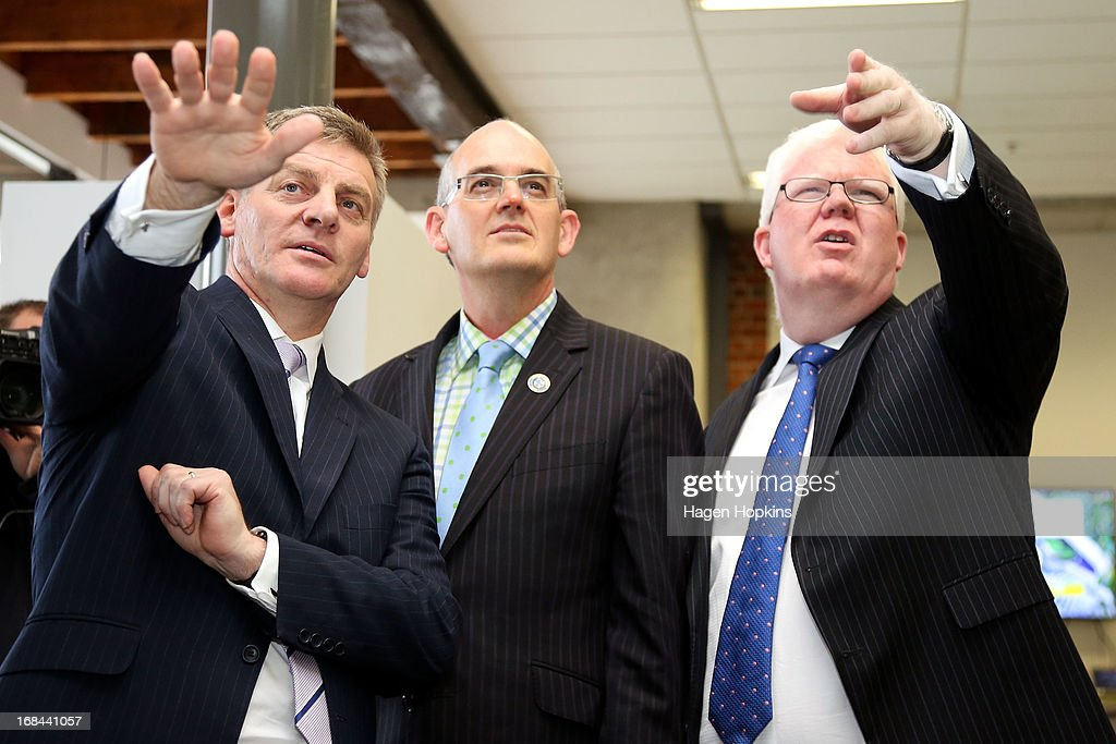 L to R, Minister of Finance <a gi-track='captionPersonalityLinkClicked' href=/galleries/search?phrase=Bill+English&family=editorial&specificpeople=772458 ng-click='$event.stopPropagation()'>Bill English</a>, Minister for State Owned Enterprises Tony Ryall and NZX CEO Tim Bennett look at the Might River Power trading board during the listing of Mighty River Power at NZX on May 10, 2013 in Wellington, New Zealand. Mighty River Power is one of several state owned enterprises being partially sold by the Government to raise capital.